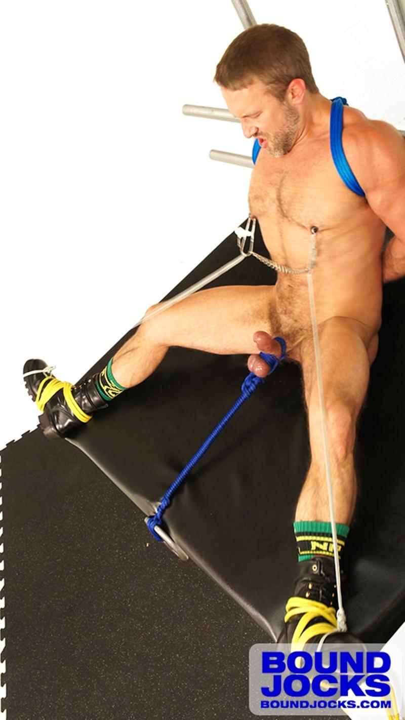 BoundJocks-Bound-jock-Dirk-Caber-hog-tied-jock-strap-vibrating-nipple-clamps-naked-weight-hangs-balls-pain-cums-cumshot-BDSM-014-gay-porn-sex-gallery-pics-video-photo