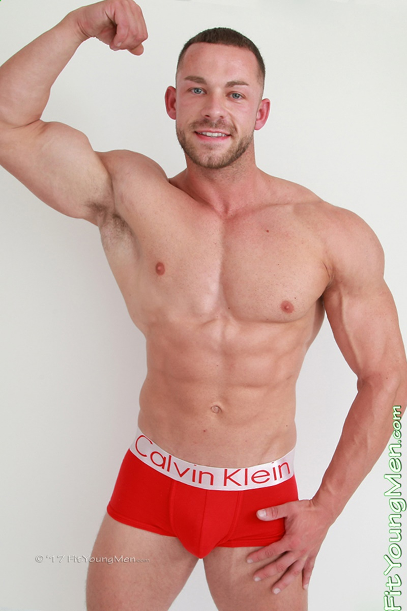 Sexy naked big muscle guy Conall Timpson strips down to his tight red undies