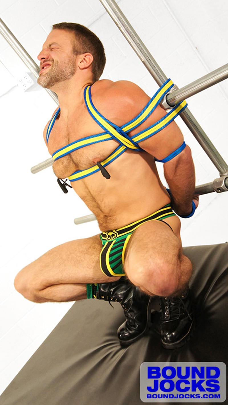 BoundJocks-Bound-jock-Dirk-Caber-hog-tied-jock-strap-vibrating-nipple-clamps-naked-weight-hangs-balls-pain-cums-cumshot-BDSM-005-gay-porn-sex-gallery-pics-video-photo
