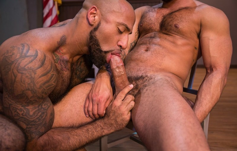 Hot tattoo hunk Daymin Voss sucks down hard on Damian Taylor's huge muscled dick