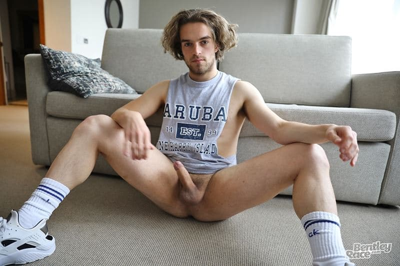 Young curly haired Aussie boy Reece Anderson strips out of his shiny shorts and muscle t-shirt jerking his huge uncut dick